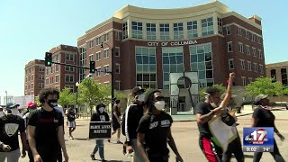 University of Missouri students protest peacefully through Columbia