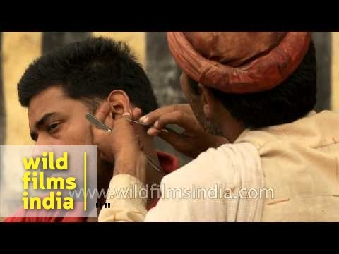 Odd jobs: Traditional Indian road-side ear cleaner
