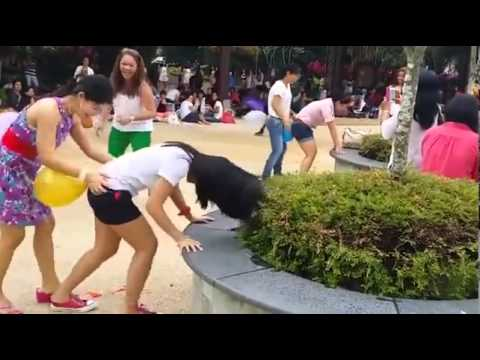 An Asian Girls Play The Balloon Popping Game video