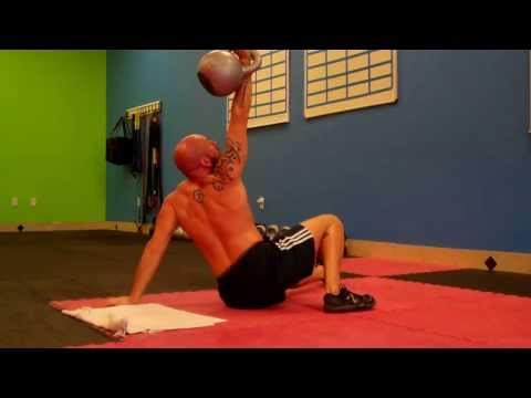 Performing Turkish Get-ups with a 32kg (70lbs) Kettlebell on Each Side Yo! Image 1