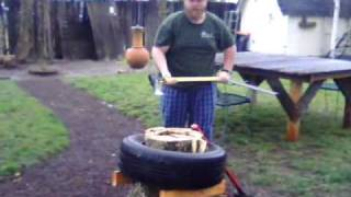 Splitting Wood With A Tire / Easy way to split  / chop  wood super fast!