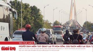 Người dân miền Tây quay lại TP.HCM sớm, cầu Rạch Miễu lại quá tải