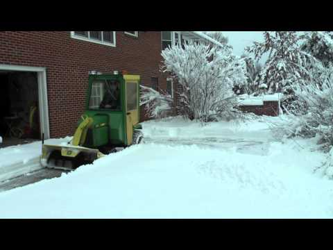 John Deere 318 throwing snow
