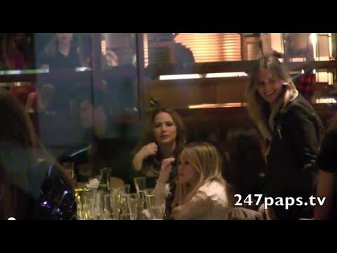 Jennifer Lawrence Mingling with friends at the SNL AfterParty , she spotted our cameras then put a menu infront of her face , she then got up and got ready t...