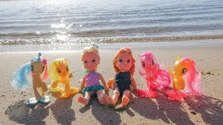 Elsa and Anna toddlers meet the sea ponies at the beach