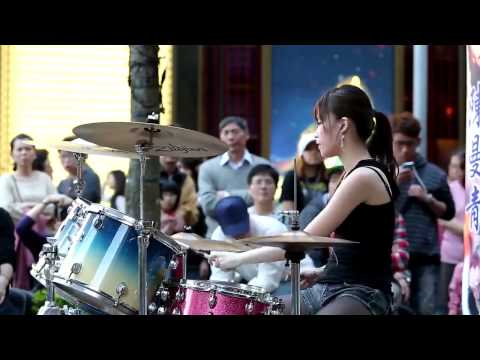 Young sexy cool cute hot girl on drum