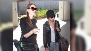 Angelina Jolie Arrives in Los Angeles With Her Mini-Movie Star Son Maddox - Splash News