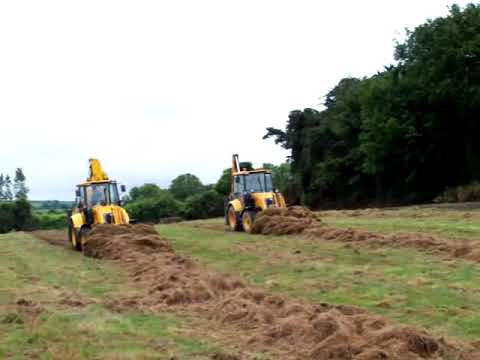 Two Fermec 860 diggers making silage...
