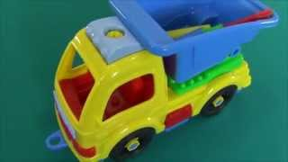 I assemble the toy car with a screwdriver and other toy instruments