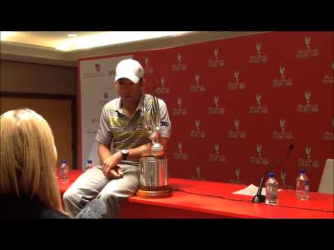 Pablo Larrazabal overjoyed with the trophy after winning the 2014 Abu Dhabi HSBC Golf Championship