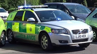 Ambulance car responding with lights and siren - Volvo V50