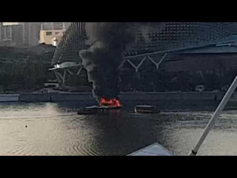 Boat on fire in Singapore River