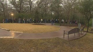 People wait in line to visit President Bush's grave site in College Station