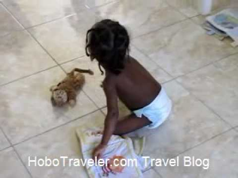 Haiti Orphan a Small Girl Pulling Body Around Room
