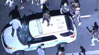 Violence erupts in Charlotte after cops kill man