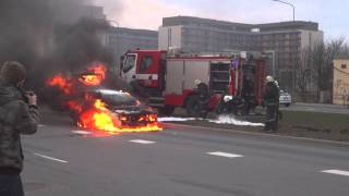 Car in fire. Latvian firemen at work.