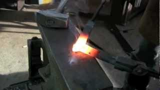 Blacksmithing - Forge-welded square-corner on flat bar.