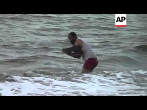 Clashes between pro and anti Morsi supporters; one man tries to escape by jumping into the sea