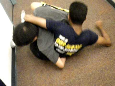 Prateek accidentally nails Tim in the balls while wrestling