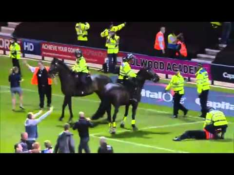 "A pitch invasion which led to a football steward being trampled by a police horse has been labelled ""completely unacceptable"" by police chiefs, who vowed to ..."