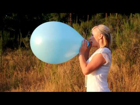 Kourtney blowing up a blue balloon until it pops - Full clip