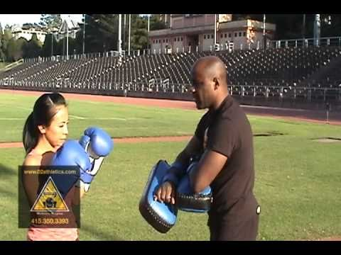 How to Hold Thai Pads for Knee Strikes Muay Thai -Basic Technique - www.02athletics.com Image 1