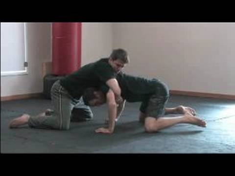 MMA Ground Fighting for Self Defense : Escape North-South Position in MMA Image 1