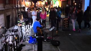 Street performer with acoustic guitar, Dublin