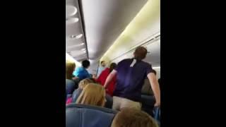 """High School choir sings """"Glory Hallelujah"""" as remains of soldier carried off plane"""
