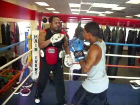 14yr.old boxer hitting focus mitts at LA Boxing Image 1