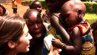 WOW: 21 yrs old serves God by mothering poor infants in Uganda!!!