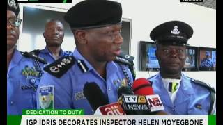 Dedication to duty : IGP Ibrahim Idris decorates Inspector Helen Moyegbone