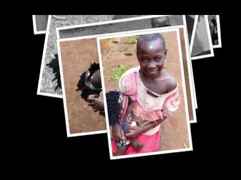 Giving out dolls and photos to the children in Uganda