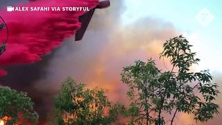Planes drop fire retardant on homes in California