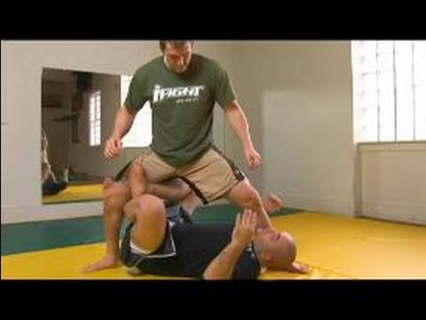 Sweeps From Guard: MMA Techniques & Training : X Guard Sweep to Taking the Back in MMA Image 1