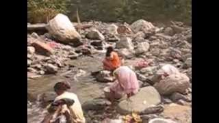 Bhutia lady combing hair after bath in river