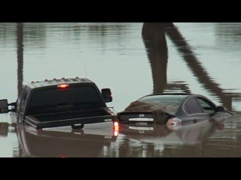 """Texans scramble to recover after """"wall of water..."""