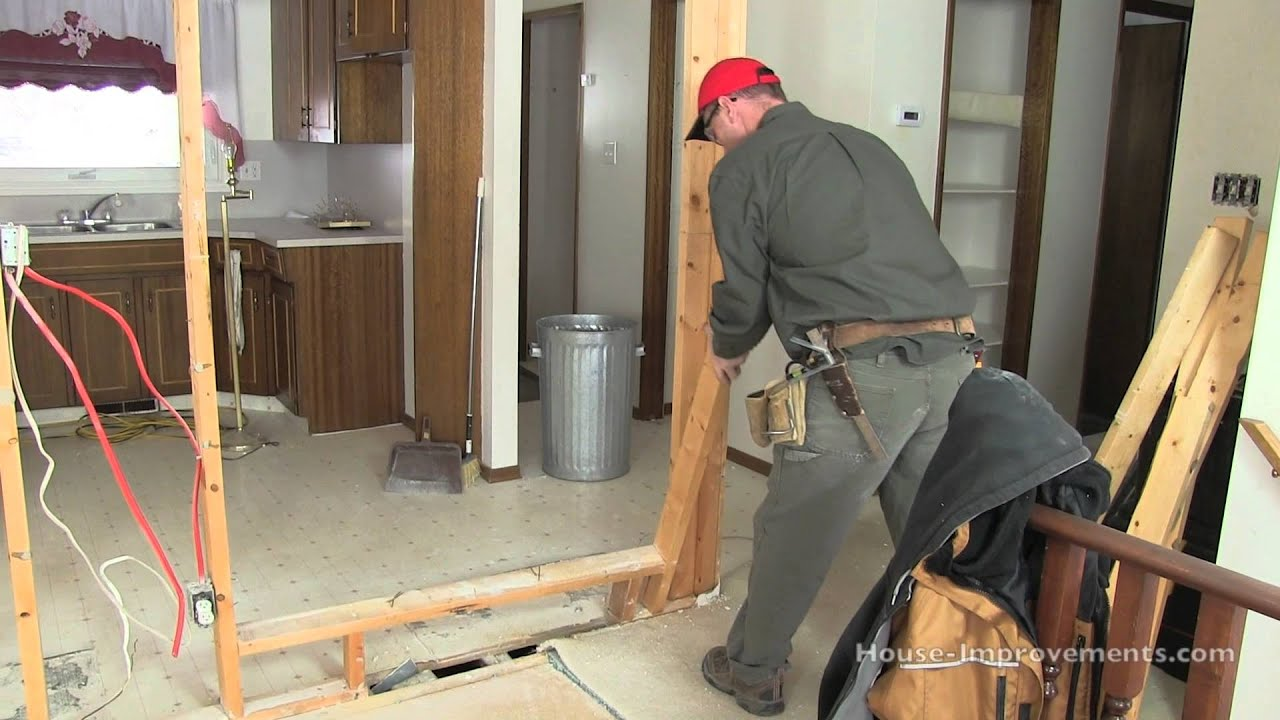 How to remove a non load bearing wall youtube for Can a load bearing wall be removed