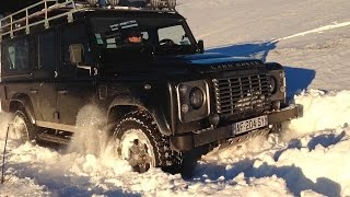 Land Rover Defenders in deep snow La Clusaz nov dec13