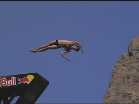 Competitors in huge cliff diving tournament in Oman
