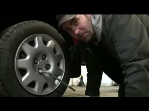 Changing a Flat Tire Using The Tools In Your Car