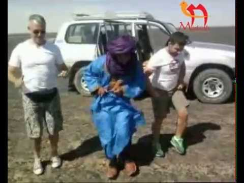 Tourist Dancing with their touareg Guide in Erg Chebbi Sahara Desert www morkosh com