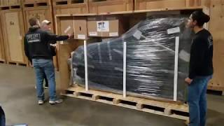 Unboxing a 9-foot Grand Piano