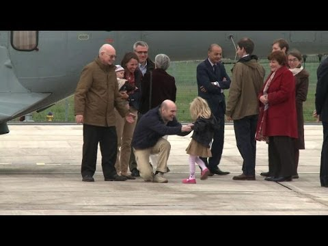 French journalists arrive home after Syria hostage ordeal