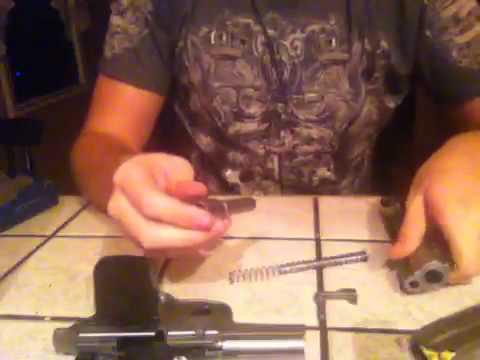 Field stripping a 40 S&W 4006 handgun