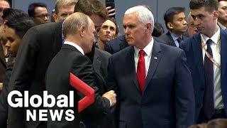 Mike Pence greets Vladimir Putin with handshake at ASEAN Summit