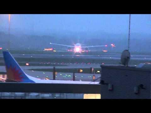 Emirates B777 landing at Manchester Airport