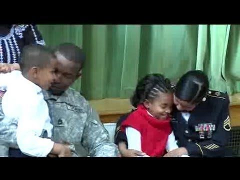Children reunited with parents in school assembly surprise