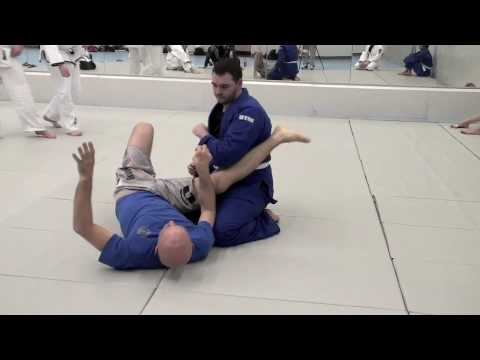 Armbar Spin-Out from Guard: Solo Drill and Partner Application Image 1