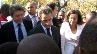 Sarkozy Makes Aid Pledge On Historic Haiti Trip
